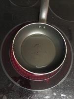 Heat oil in pan