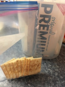 Add crackers to bag